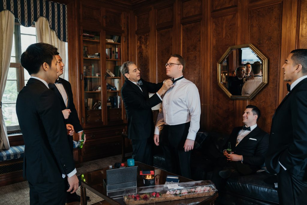 Groom getting ready for a wedding with his groomsmen