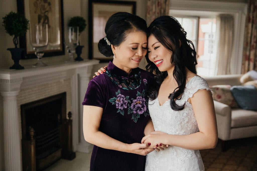 Bride and her mom holding hands on the wedding day