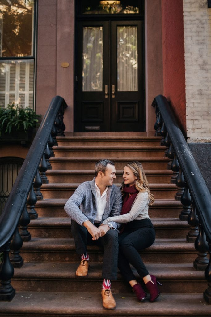 Couple sitting on the stairs in Manhatten New York