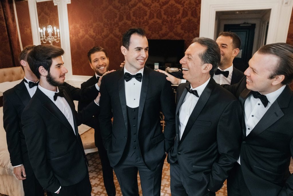 Groom getting ready at The St. Regis NYC in New York