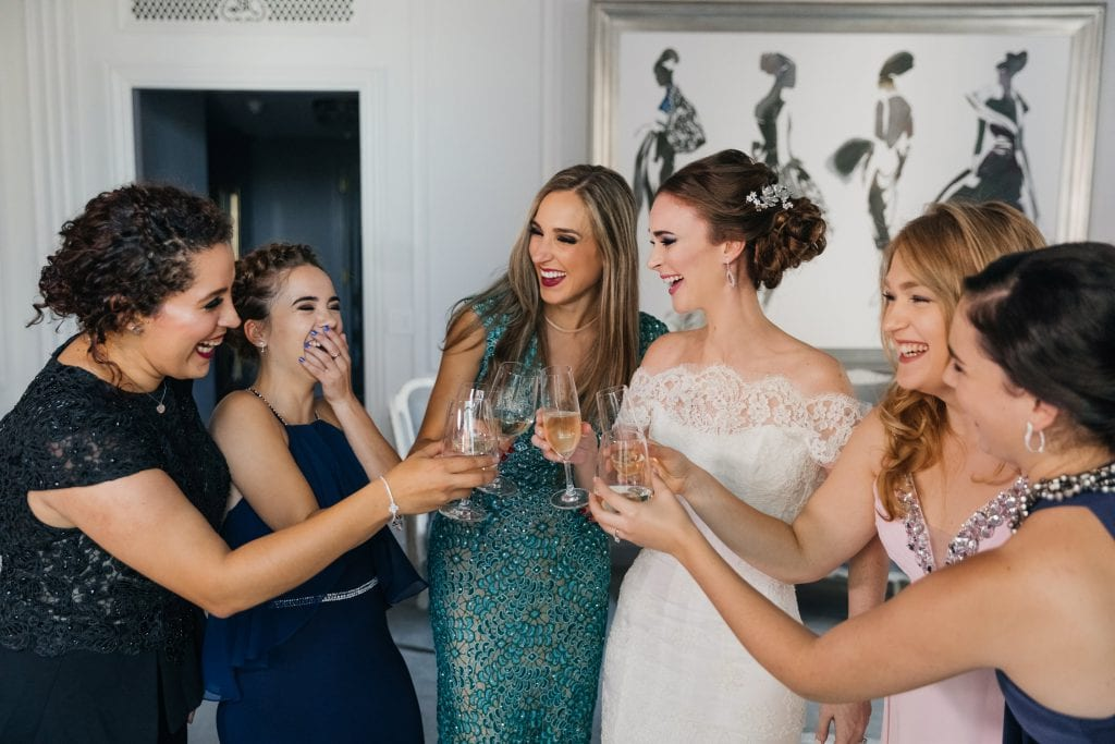 A bride and her bridesmaids celebrating the bride's wedding day at The St. Regis NYC