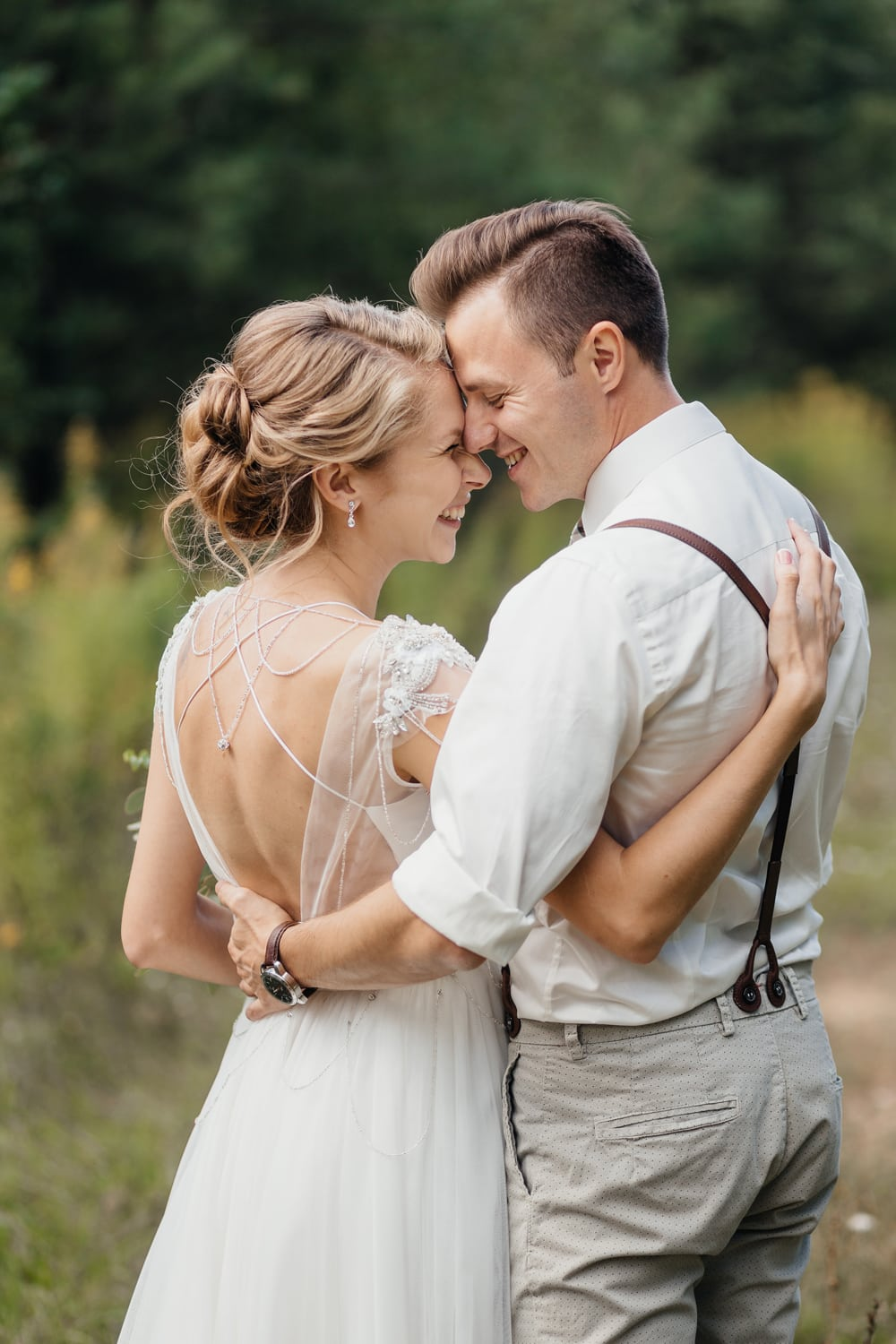 Rustic bride and groom touching each other with their foreheads during portrait photoshoot in the Catskills