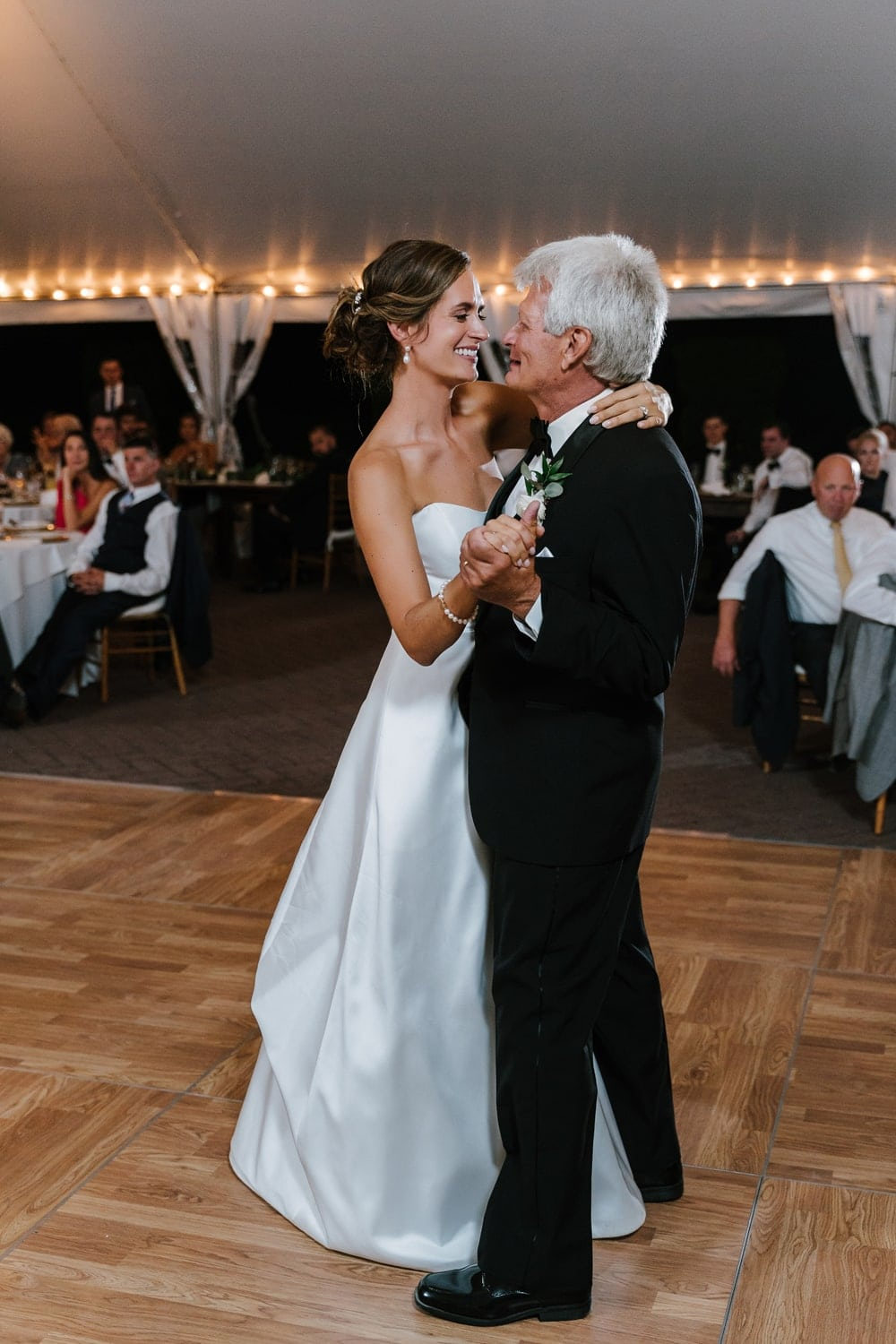 A bride dancing with her father during a wedding reception
