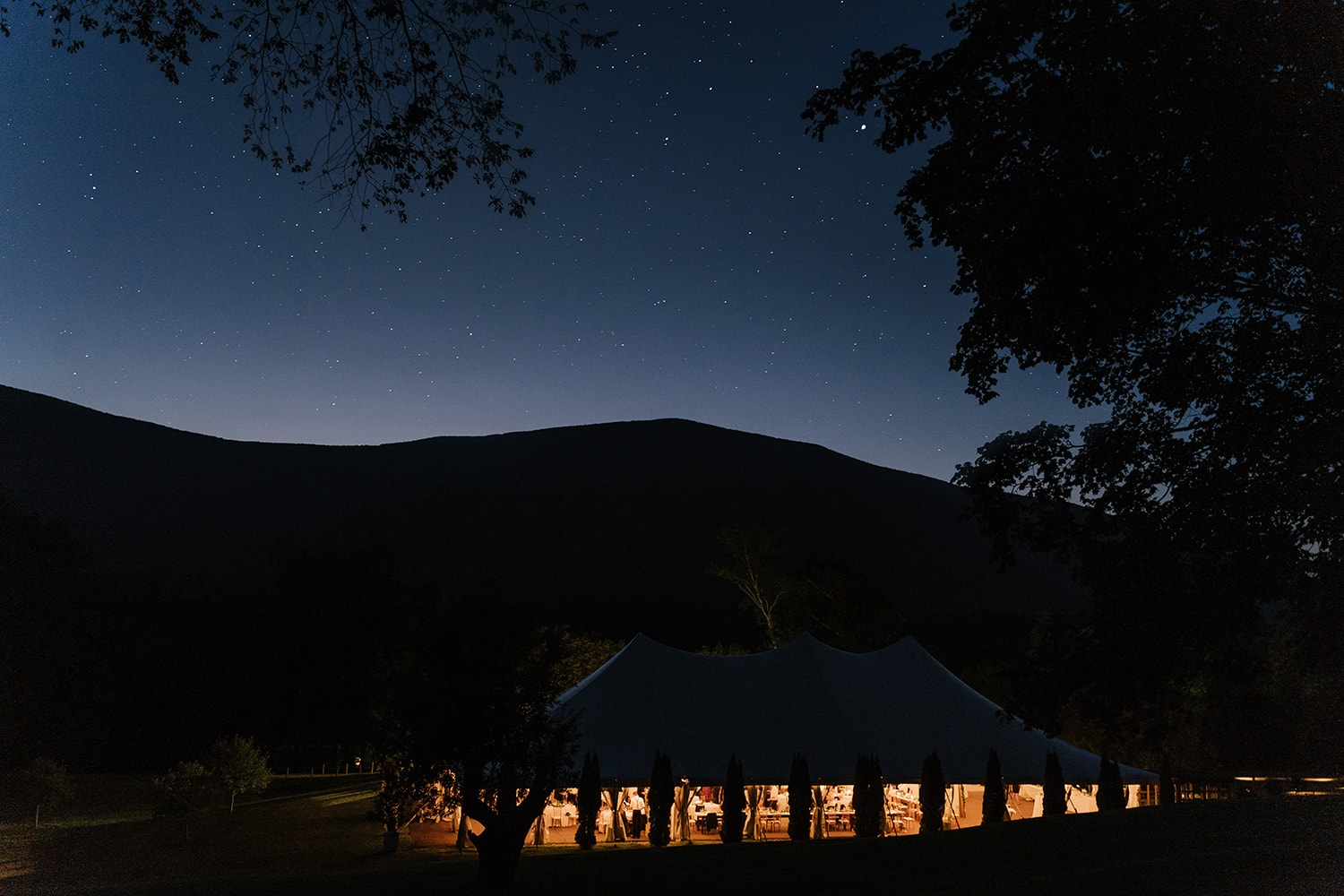 A wedding tent at Hildene in the night