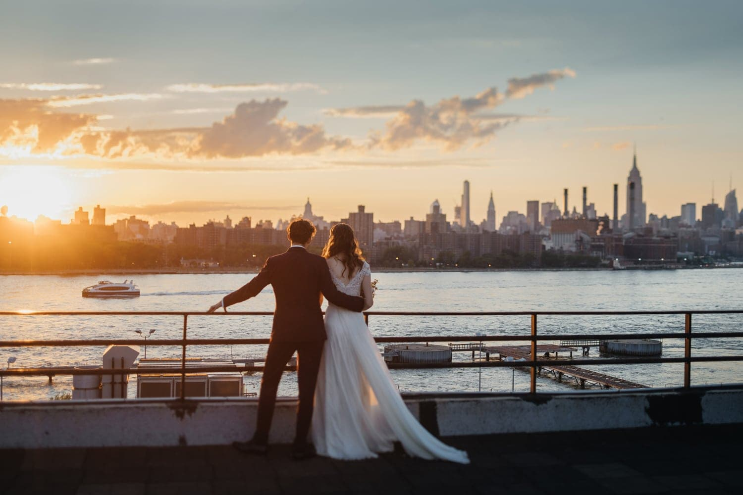 Bride and Groom posing at the W Loft, Brooklyn with Manhattan view