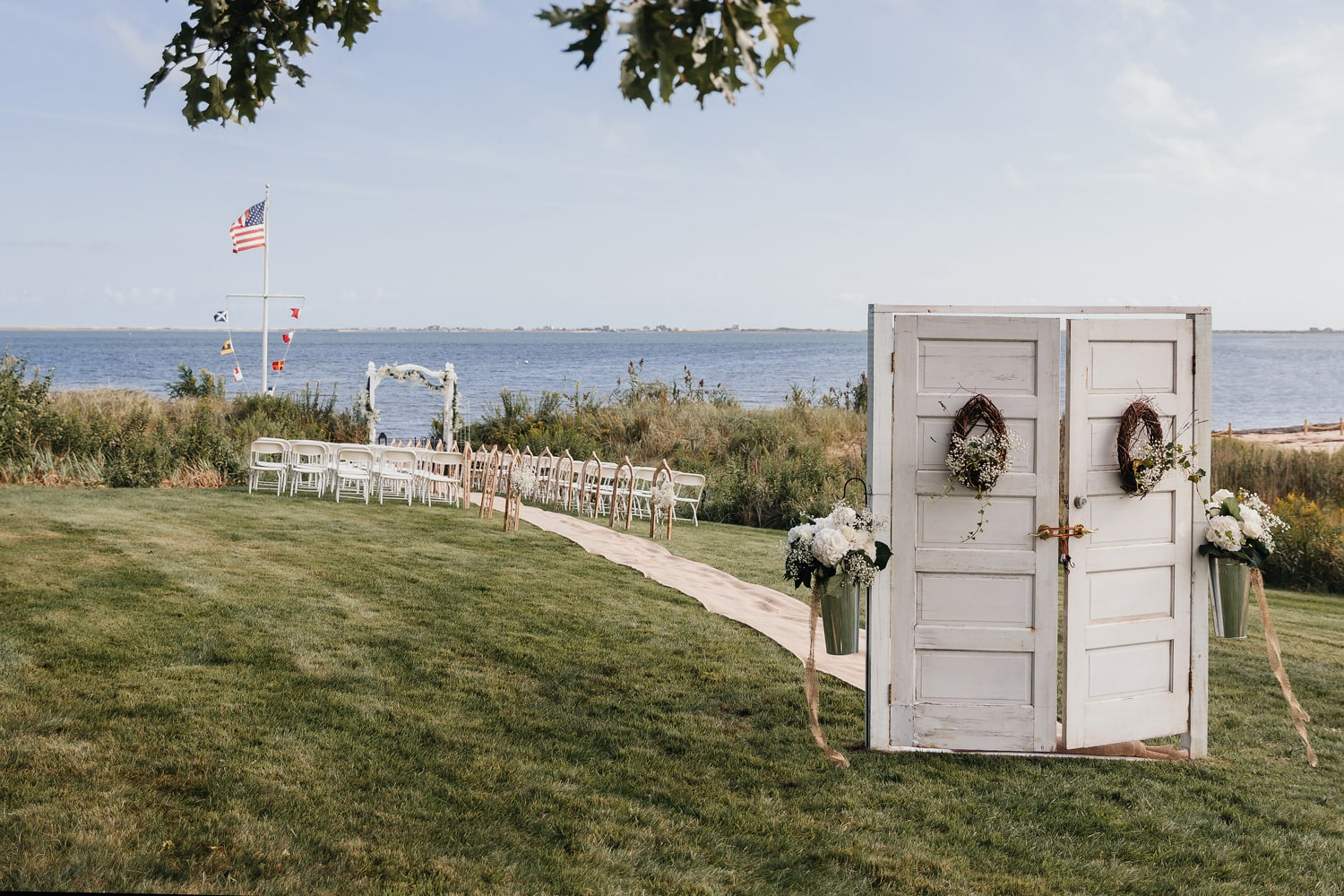 Rustic wedding ceremony setting near the water in the Hamptons