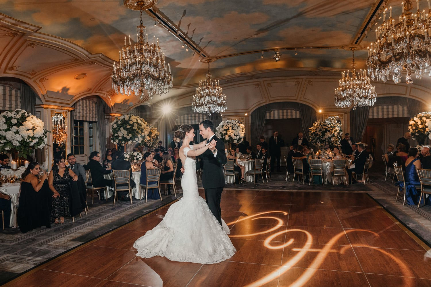 Bride and groom dancing their first dance at the St. Regis New York hotel