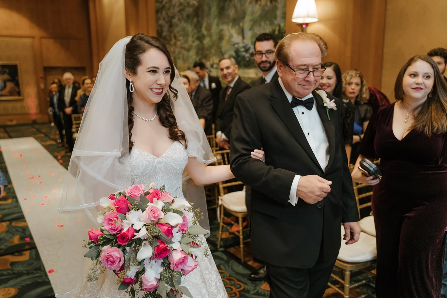 A bride and her father walking during the wedding ceremony