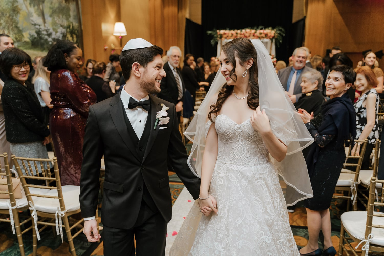 A newly wedded couple exiting their wedding ceremony