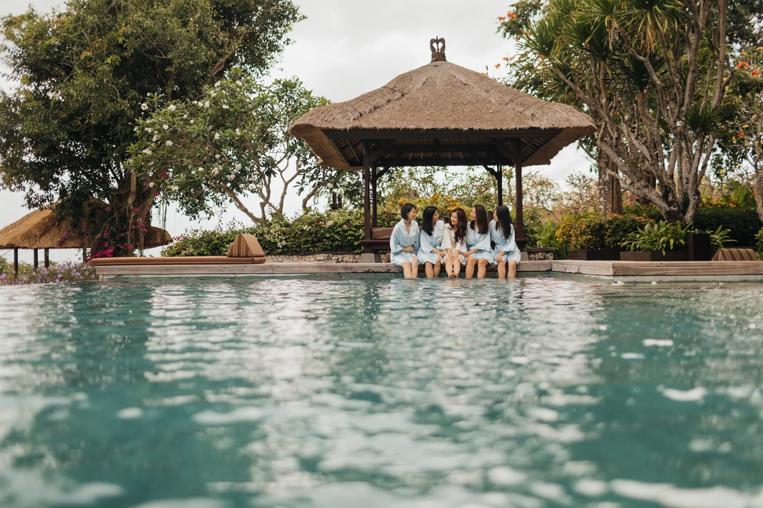 A bride and her bridesmaids posing for a picture at Ayana Villa